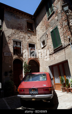 Old Fiat 100 in a house courtyard in an italian village, Tuscany, Italy, Mediterranean Europe - Stock Photo