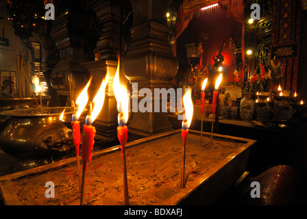 Burning candles in front of a Chinese Buddhist altar in the Man Mo Temple, Hong Kong, China, Asia - Stock Photo