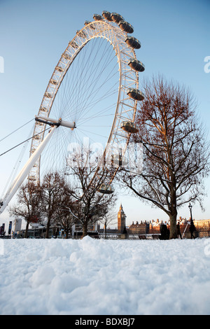 LONDON: BIG BEN AND MILLENNIUM EYE IN THE SNOW - Stock Photo