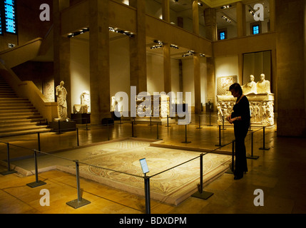 A visitor to the National Museum of Beirut pauses at the Calliope Mosaic of the Seven Wise Men, which was unearthed - Stock Photo
