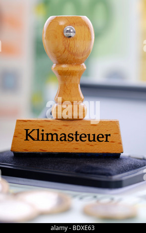 Stamp labelled 'Klimasteuer', German for 'climate tax' - Stock Photo