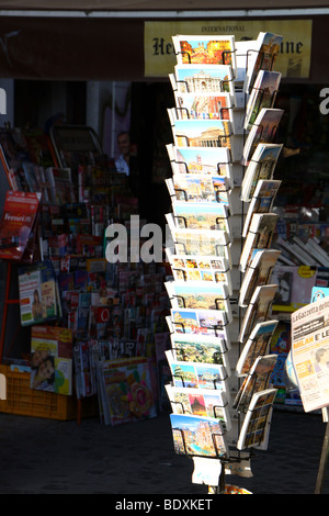 Postcard rack at a newspaper kiosk in Rome, Italy. - Stock Photo