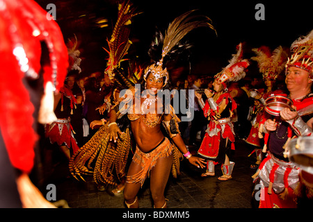 woman wearing carnival costume in a parade - Stock Photo
