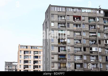 Warsaw Poland old style communist era public housing concrete flats note renovated bloc behind taken Summer 2009 - Stock Photo