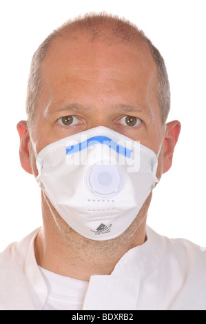 Physician wearing a virus-proof face mask - Stock Photo