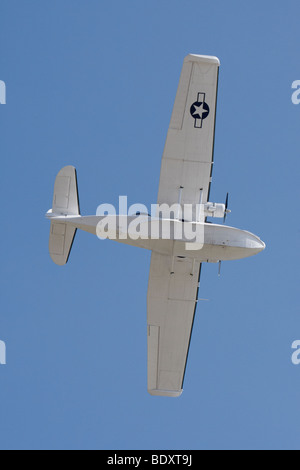 Catalina in flight at Clacton, Essex, England, United Kingdom - Stock Photo