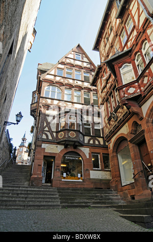 Second hand bookshop, shop for antique books, Steile Strasse street, stairs, historic half-timbered houses, historic - Stock Photo