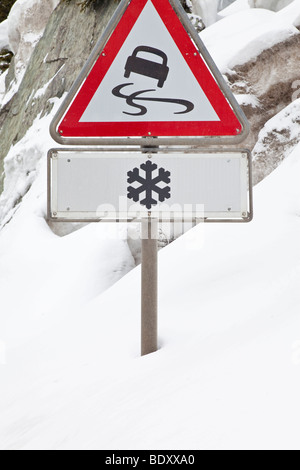 Slippery Road warning sign, Graubunden region, Swiss Alps, Switzerland, Europe - Stock Photo