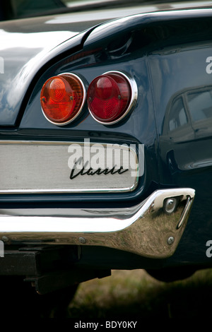 Close up of rear light cluster of a 1960's Ford Classic. - Stock Photo