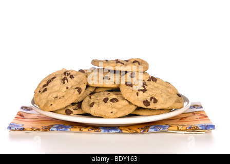 A plate of chocolate chip cookies with a white background. - Stock Photo
