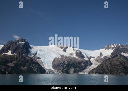 Seward, Alaska - Northwestern Glacier spills into Northwestern Fjord in Kenai Fjords National Park. - Stock Photo