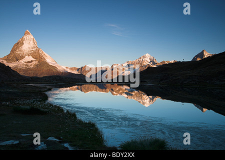 Reflection of Mt. Matterhorn in the Riffelsee lake, Valais, Switzerland, Europe - Stock Photo