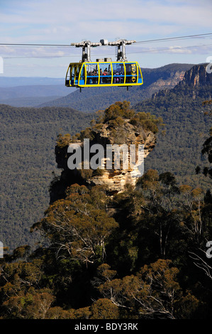 Scenic Skyway cable car from the Scenic World Complex in front of Orphan Rock, Jamison Valley, Blue Mountains National - Stock Photo