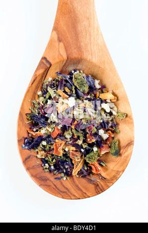 Spice mix of dried seaweed, Dulse, Wakame, Nori, Kombu, seaweed, sea salt on a spoon of olive wood
