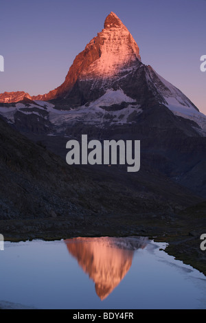 Reflection of the Matterhorn mountain in the Riffelsee lake, Valais, Switzerland, Europe - Stock Photo