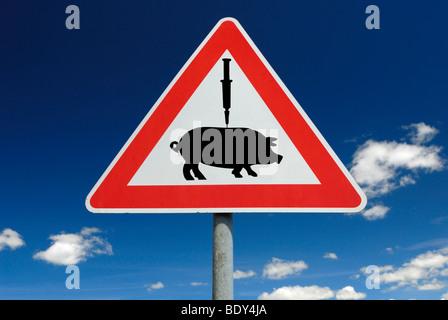 Traffic sign, vaccination against swine flu - Stock Photo