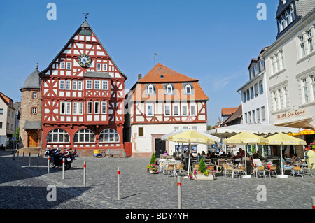 Town hall square, sidewalk cafe, historic half-timbered houses, town hall, Kirchhain, Kassel, Hesse, Germany, Europe - Stock Photo