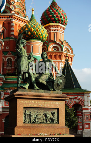 Statue of Minin and Pozharsky against St. Basil's Cathedral on Red Square, Moscow, Russia - Stock Photo