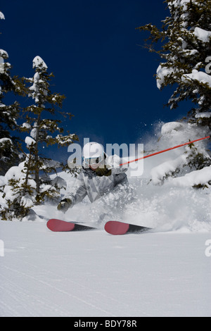 Man in white & grey camo suit off-piste. - Stock Photo