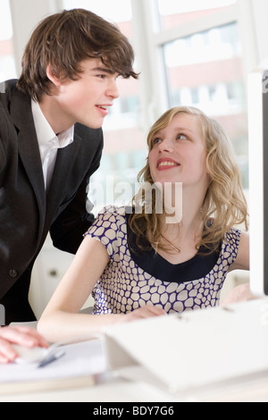 man is teaching something to a woman - Stock Photo