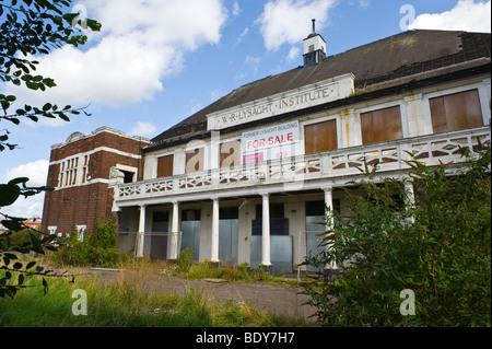 Exterior facade of derelict and for sale boarded up former steelworkers institute in city of Newport South Wales - Stock Photo