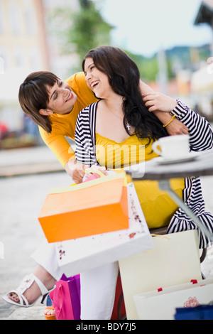 girlfriends meet at a street cafe - Stock Photo