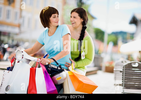 girlfriends with motor scooter - Stock Photo