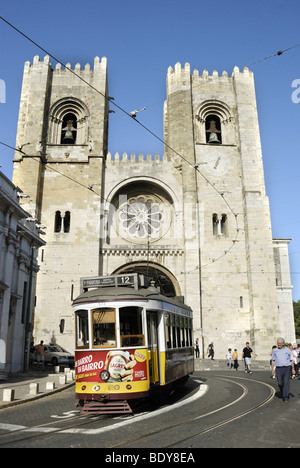 Yellow tram in front of the Catedral Sé Patriarcal cathedral, Lisbon, Portugal, Europe - Stock Photo