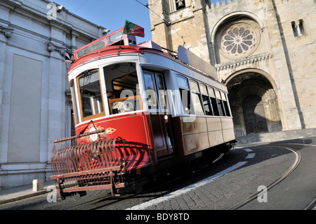 Red tram in front of the Catedral Sé Patriarcal cathedral, Lisbon, Portugal, Europe - Stock Photo