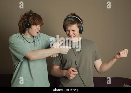 Boys playing air guitars - Stock Photo