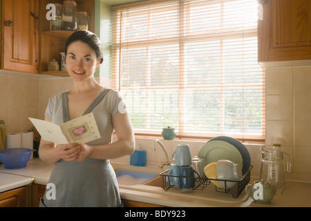 Woman with Valentines card - Stock Photo