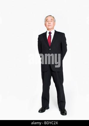A full length portrait of an Asian man - Stock Photo