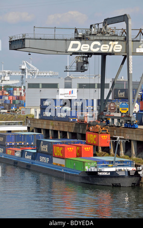 Cargo ship is being loaded, inland port in Duisburg, North Rhine-Westphalia, Germany, Europe - Stock Photo
