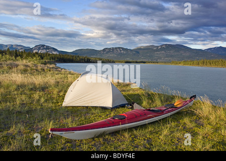 Tent, sea kayak on the shore, evening, camping, Yukon River, Yukon Territory, Canada - Stock Photo