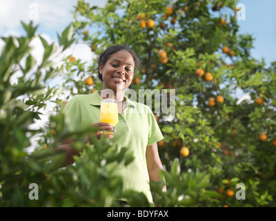 Woman With Glass Of Fresh Orange Juice - Stock Photo