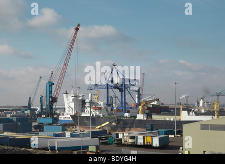 Ship Being Loaded At A Port - Stock Photo