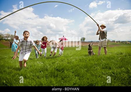 Family having fun in countryside - Stock Photo
