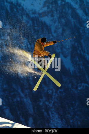 Skier jumping performing a trick - Stock Photo
