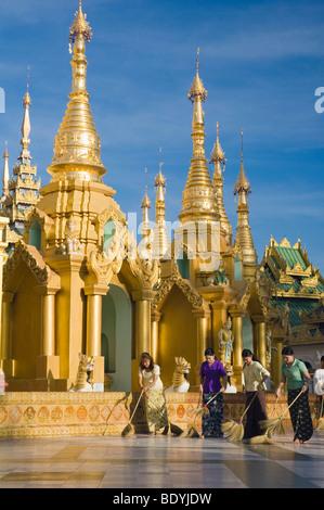Women sweeping the Shwedagon pagoda, temple, Rangoon, Yangon, Burma, Myanmar, Asia - Stock Photo