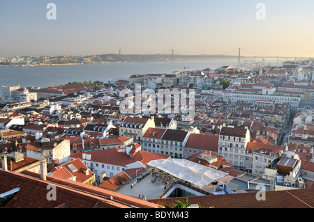 Overlooking the historic city centre of Lisbon and the Tagus River, Portugal, Europe - Stock Photo