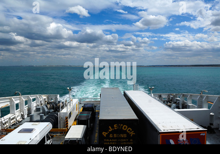 Trucks and cars at the rear of the car ferry Seafrance on the crossing from Calais-Dover, in the rear the coast - Stock Photo