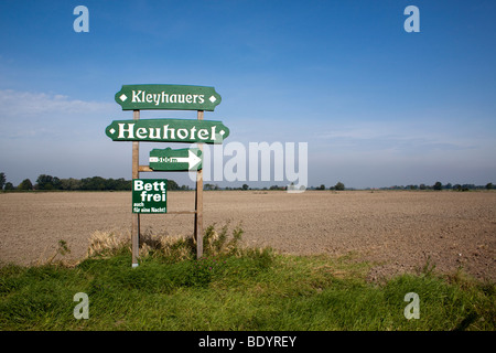 Sign for a hay hotel in an East frisian landscape, Lower Saxony, Germany, Europe - Stock Photo