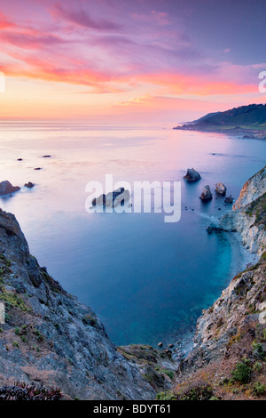 Sunset with offshore rocks. Big Sur coast. California - Stock Photo