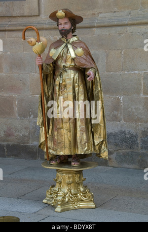 Mime artist, street artist, representing a pilgrim with pilgrim's staff, calabash and scallops, in Santiago de Compostela, - Stock Photo