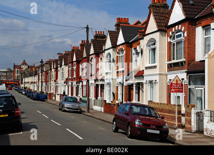 Typical English terraced houses with telephone lines, Undine Street, Tooting Broadway, London, England, Europe - Stock Photo