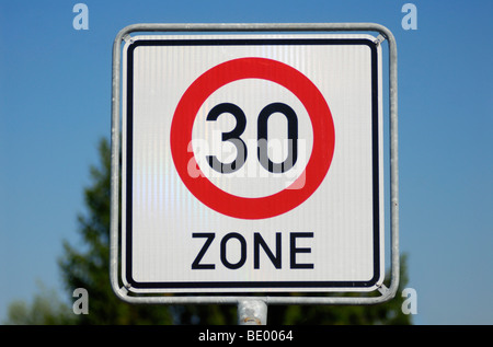 Speed limit sign of a 30 km/h restriction zone - Stock Photo