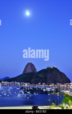 Sugarloaf Mountain, Pão de Açúcar, at night with full moon, Rio de Janeiro, Brazil, South America - Stock Photo