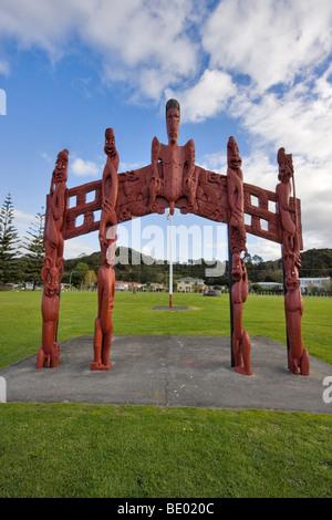 Maori totem poles in a field in the village of Waitangi, Paihia, Bay of Islands, New Zealand - Stock Photo