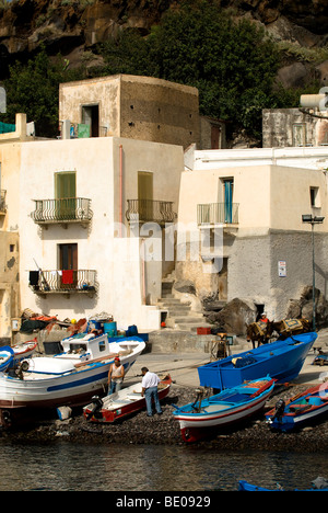 Fisherman and boats, Filicudi, Eolie Islands, Sicily, Italy - Stock Photo