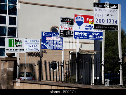 Multiple sale signs for selling and letting houses, property market, Edinburgh Scotland, UK, Europe - Stock Photo